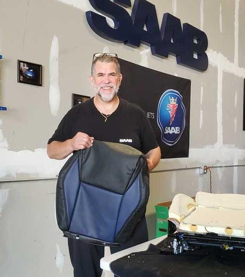 Gary is about to install a special edition seat cover, only one other set made in the entire world.